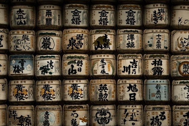 Sake containers piled up against a wall.