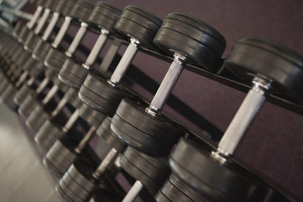 Dumbbells on a rack at a gym.