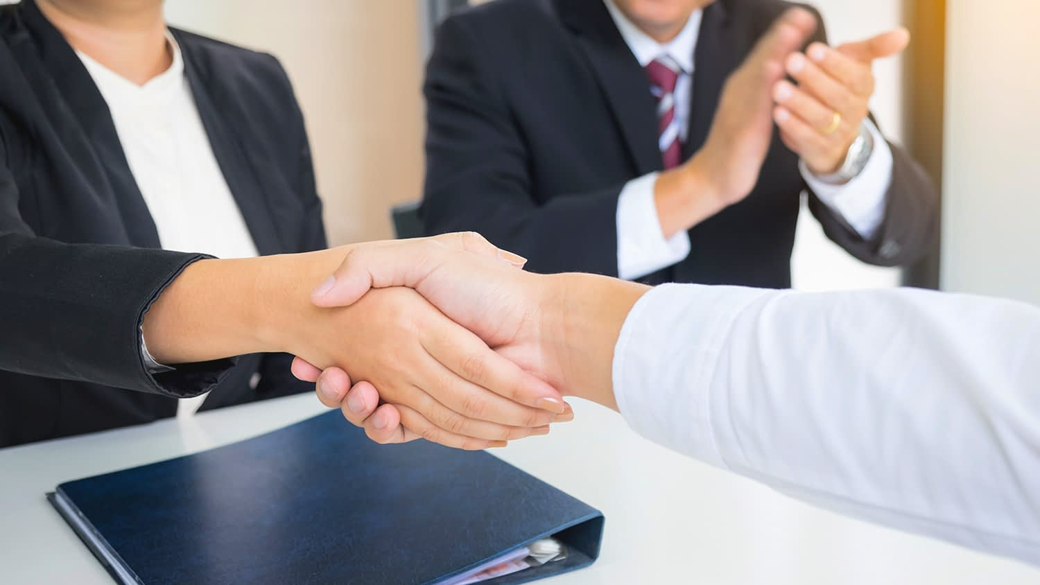 successful business team shaking hands with eachother in the office